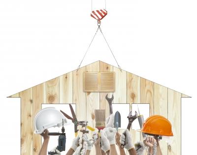home on hanger with contractors below