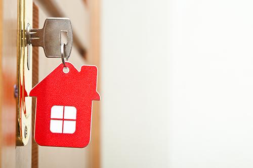 key in door of home